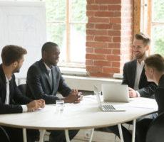 business-men-around-table